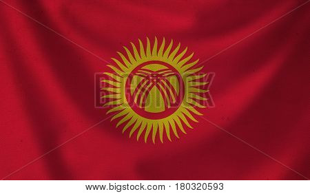 Vintage background with flag of Kyrgyzstan. Grunge style.