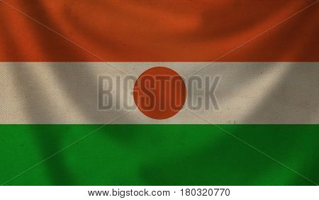 Vintage background with flag of Niger. Grunge style.