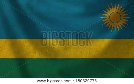 Vintage background with flag of Rwanda. Grunge style.