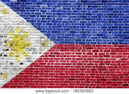 Flag of Philippines painted on brick wall, background texture