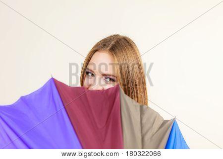 Shy Woman Hiding Behind Colorful Umbrella
