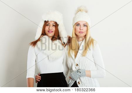 Two Women With Winter Clothes.
