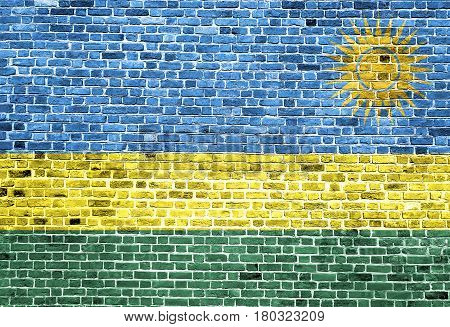Flag of Rwanda painted on brick wall, background texture