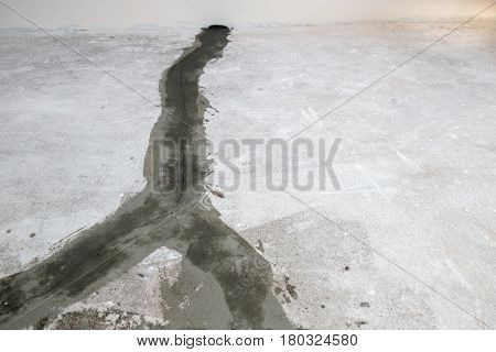seal of cracks on a concrete floor.The going person