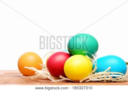Painted Easter Colorful Eggs With Straw Nest Isolated On White