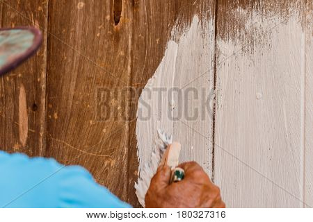 Painters are painting wooden houses in construc side.