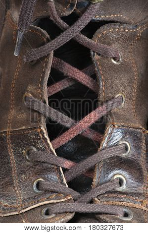 a fragment of the lacing on leather shoe, closeup