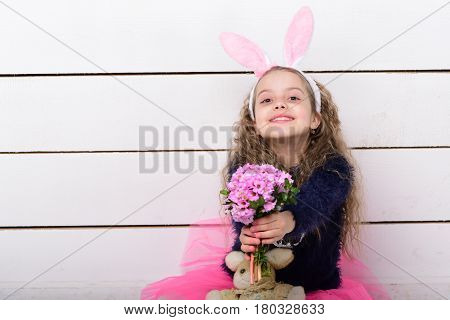 Happy Girl In Bunny Ears With Easter Rabbit Toy, Flowers