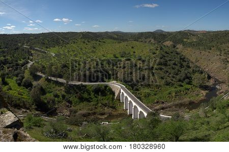 Bridge Over River Oeiras And Winding Road At Mertola