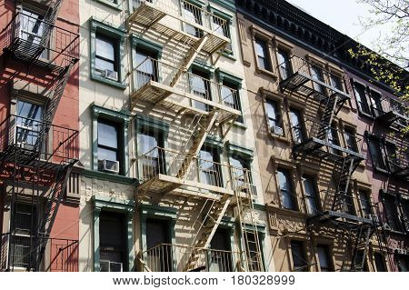 old buildings of New York City with metal stairs in front typical architecture