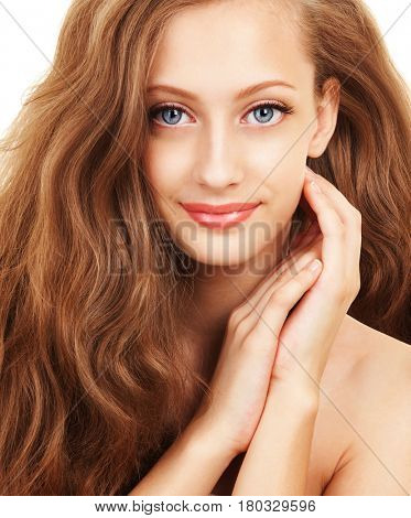 Portrait of young woman with beautiful hair. Care for beautiful woman health, hair and skin. Cosmetology, spa therapy and hair care at beauty salon. Closeup portrait of woman