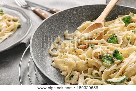 Frying pan with delicious chicken Alfredo, closeup