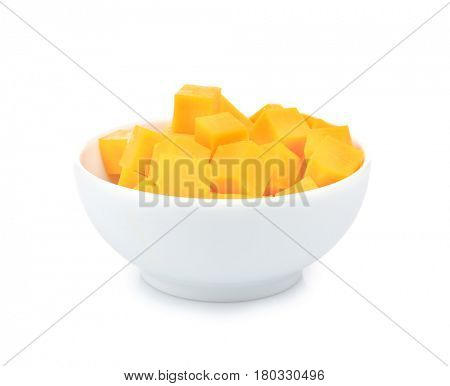 Delicious pieces of cheddar in bowl on white background