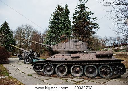 Old Vintage Military Tank In The City Pedestal.