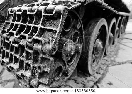 Detail Shot With Old Vintage Tank Tracks And Wheels.