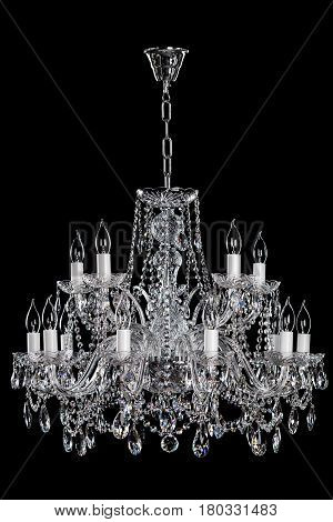 Magnificent lamp on the dark background. Metal is chrome. Nice decoration for your home. Large hanging lamp.