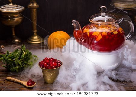 Cranberry berry tea with a cranberry and orange, with addition of sugar syrup