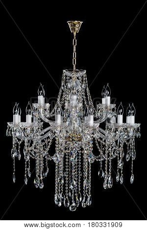 Magnificent gold lamp on the dark background. Large hanging lamp. Luxury chandelier.