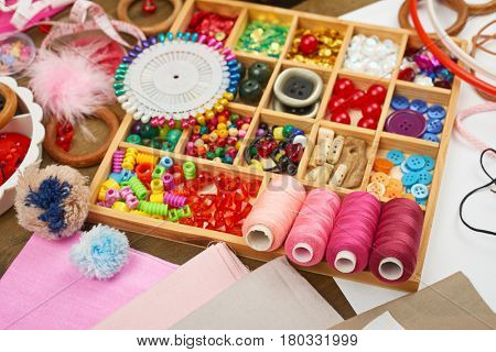 thread and sewing accessories top view, seamstress workplace, many object for needlework, embroidery, handmade and handicraft