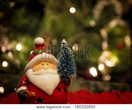 Santa Claus decoration with Christmas tree behind