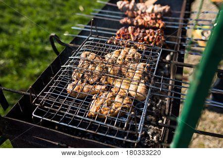 Grilling Marinated Shashlik On A Grill. Shashlik Is A Form Of Shish Kebab Popular In Eastern, Centra