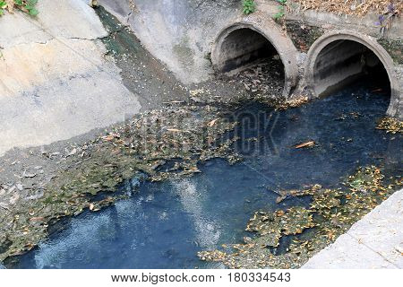 Toxic water running from sewers in dirty underground sewer for dredging drain tunnel cleaning in the city Waste-pipe.