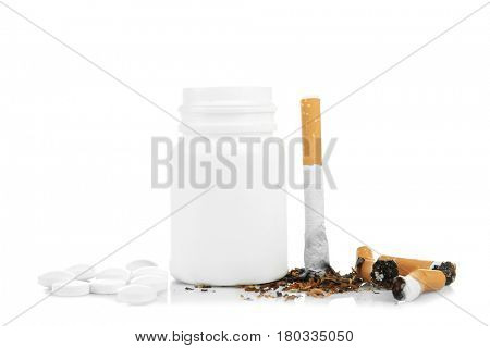 Damaged cigarettes and pills isolated on white