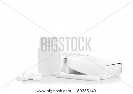 Cigarette, pack and pills isolated on white