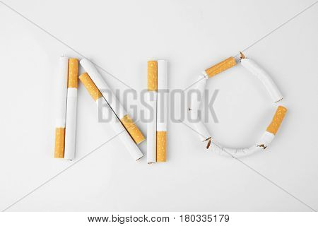 Word NO made of cigarettes on white background