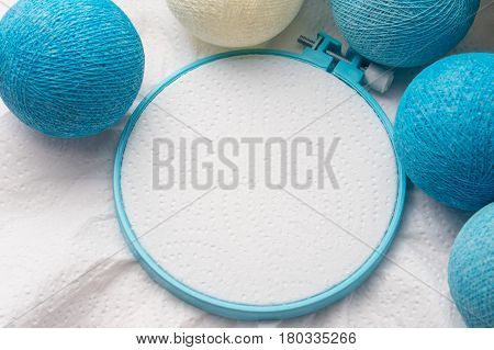 Embroidery hoop with blank fabric and christmas balls decoration
