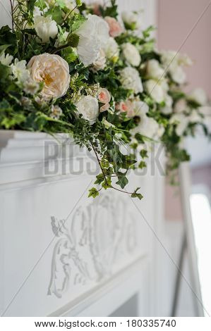Flower arrangement with branches of a pistachio branches of Ruscus, carnations, roses, branch of Brunei, berries of Hypericum. Wedding concept.