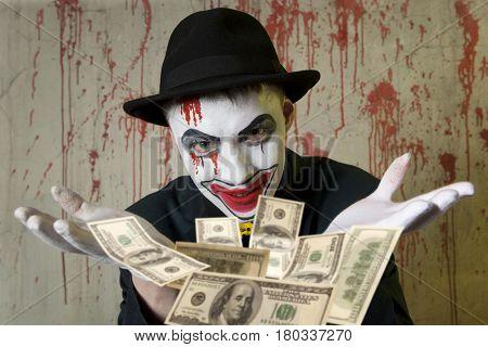 Scary evil clown throwing dollar