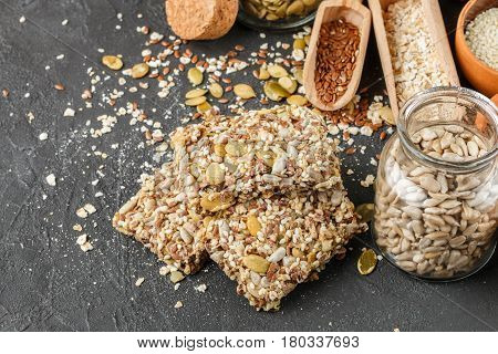 Healthy Snack - Crispy Cereal Cookies On Black Stone Table And Ingredients: Oat Flakes, Flax Seed, P