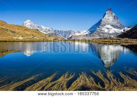 Mt Matterhorn reflected in Riffelsee Lake Zermatt Canton of Valais Switzerland