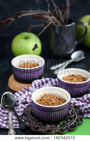 Homemade delicious apple crumble crisp dessert on dark