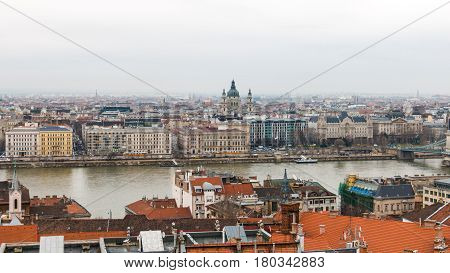 Scenic view of Pest side with St. Stephen's Basilica in center and Danube river in Budapest Hungary with haze on the horizon after the rain