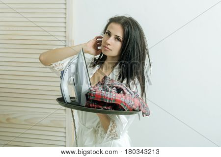 Pretty Girl Or Housewife With Iron And Clothes On Tray