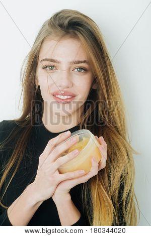 Happy Pretty Girl Putting Gel Or Balm On Sexy Lips