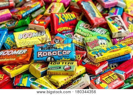 ASHDOD, ISRAEL - SEPTEMBER 27, 2015: Many various colorful chewing or bubble gum from seventies, eighties and nineties, including Robocop, Turbo, Donald Duck, BomBibom, TipiTip, X-Men, Dunkin