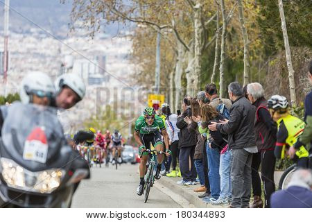 Barcelona Spain - March27 2016: The Spanish cyclist Lluis Mas Bonet of Caja Rural-Seguros RGA Team riding in front of the peloton on the road to the top of Montjuic in Bracelona Spain during Volta Ciclista a Catalunya on March 27 2016.