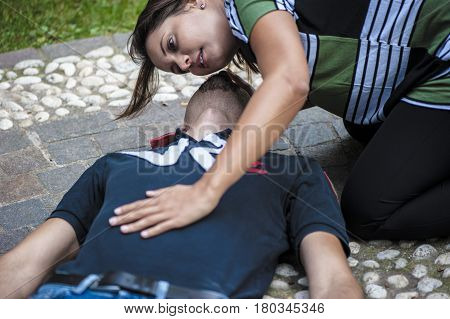 a girl helping a young guy after an heart attack with cardiopulmonary resuscitation poster