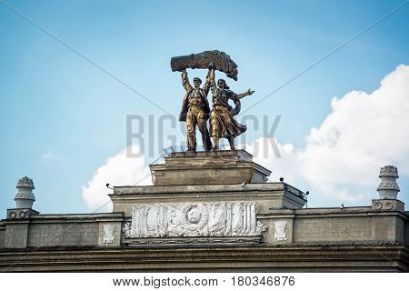 MOSCOW - JULY 29, 2016: Old soviet architecture in VDNKh park, Moscow. Detail of main entrance.