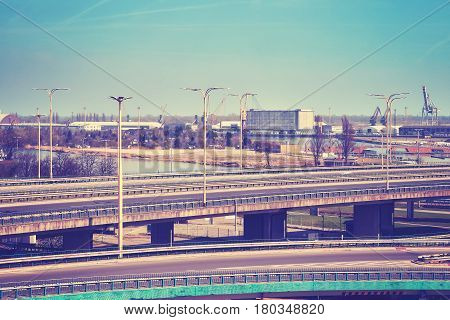 Highway overpass with port infrastructure in background color toning applied Szczecin Poland.