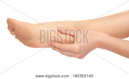 Leg of young woman suffering from pain in heel on white background