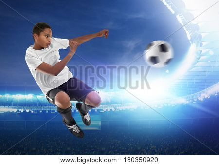 African-American boy playing football at stadium