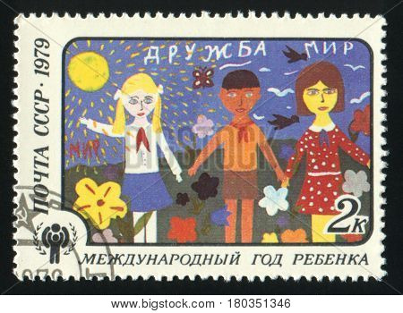 USSR - CIRCA 1979: A stamp printed in USSR shows the Children drawing Friendship, from the series International Year of the Child, circa 1979