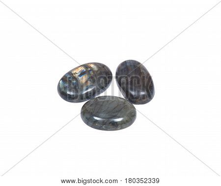Labradorite cabochons free-form from Madagascar isolated on white background
