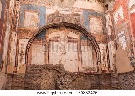 Wall mosaic in Herculaneum archeological site. Naples Italy