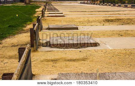 Row Of Horseshoe Pits With Raised Wood Platforms