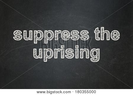 Political concept: text Suppress The Uprising on Black chalkboard background